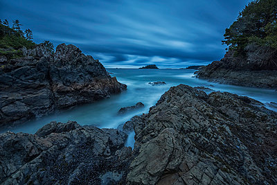 Six minute exposure of the clouds and ocean mackenzie beach;Tofino british columbia canada - p442m804919f by Robert Postma