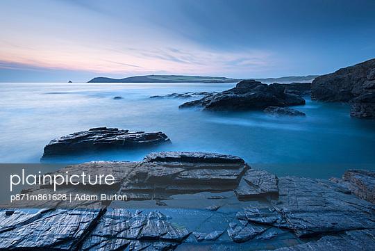 Trevose Head at dusk from Treyarnon Point - p871m861628 by Adam Burton