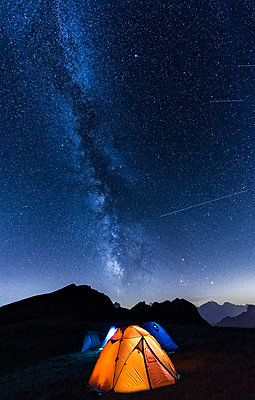 Italy, Dolomites, Milky Way over Monte Pelmo with tents of camp in the foreground - p300m1189466 by Lorenzo Mattei