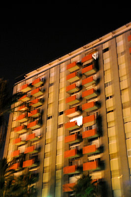 Spanish apartment block at night in Barcelona - p1072m829275 by Neville Mountford-Hoare