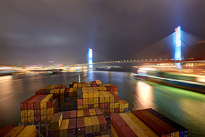 Container ship at night in Hong Kong I - p1099m857104 by Sabine Vielmo