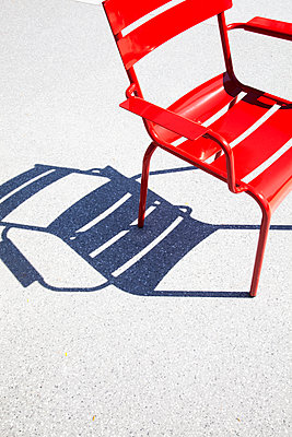 Red Metal Chair on Square  - p1248m2063469 by miguel sobreira