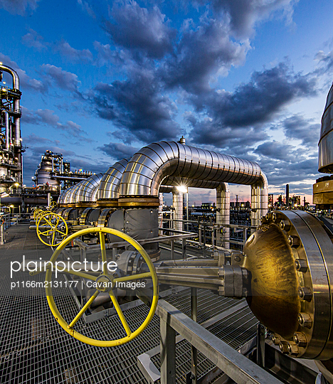Dusk as viewed through pipe in a refinery - p1166m2131177 by Cavan Images