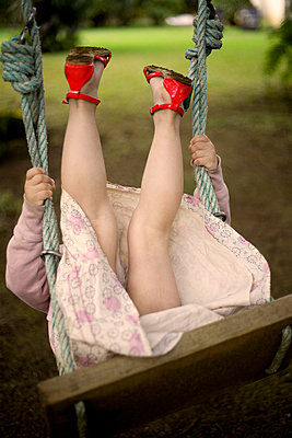 Girl on a swing - p1430m1503593 by Charlotte Bresson