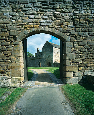 Aydon Castle. Archway in crenellated wall leading into outer courtyard . - p8551693 by Keith Buck