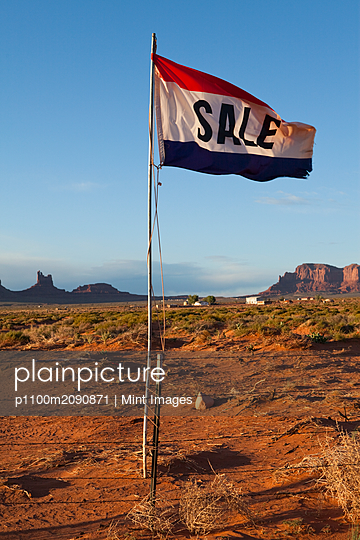 Sale Flag in the Desert - p1100m2090871 by Mint Images