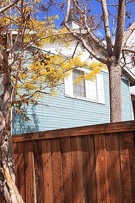 Wodden house behind wooden fence - p0452701 by Jasmin Sander