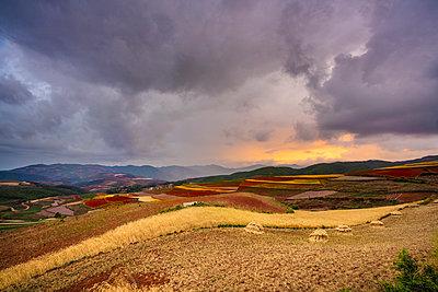 China, Yunnan province, Dongchuan, Red Land and dramatic sky - p300m2029524 by Kike Arnaiz