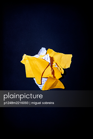Torn Bits of Letter and Yellow Envelope - p1248m2216093 by miguel sobreira