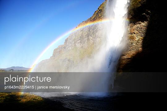 Rainbow at waterfall - p1643m2229415 by janice mersiovsky