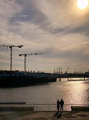 Evening at the port of Hamburg - p382m2184630 by Anna Matzen