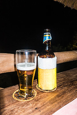 Beer on the porch - p930m1541602 by Ignatio Bravo