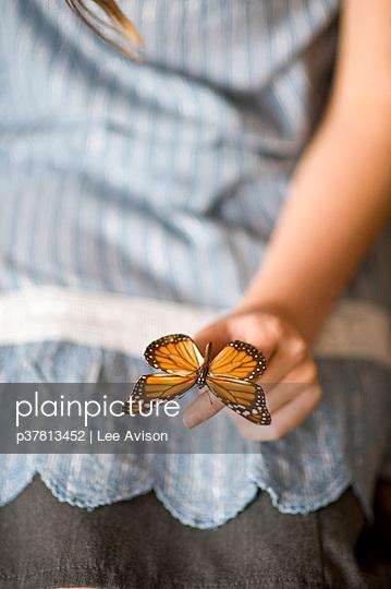 Butterfly on girls hand - p37813452 by Lee Avison