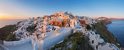 View of Oia village in sunset at Santorini - p300m731251f by Martin Rügner