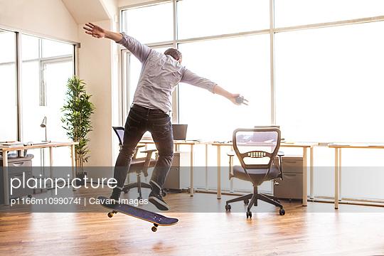 Man skateboarding in office