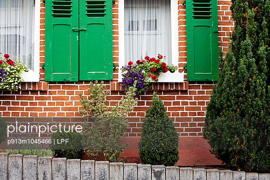 House with window shutters - p913m1045466 by LPF