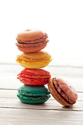 Stacked colorful macarons on wood - p300m998018f by Dieter Heinemann