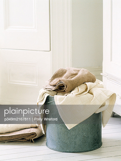 Mop bucket and messy towels for laundry - p349m2167811 by Polly Wreford