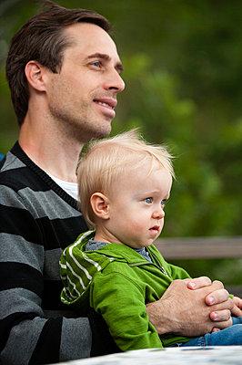 Portrait of man with son - p575m696320f by Fredrik Schlyter