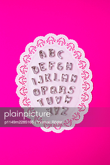 Alphabet cookie cutters on paper doilies - p1149m2285165 by Yvonne Röder
