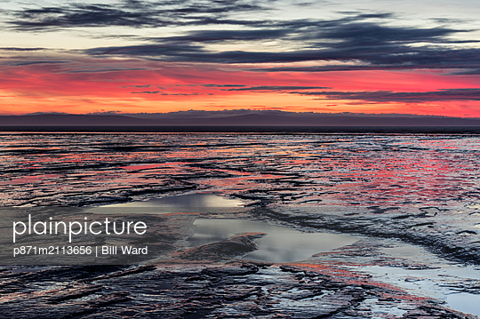 Brean Beach at sunset, mud and the Bristol Channel, Somerset, England, United Kingdom - p871m2113656 by Bill Ward