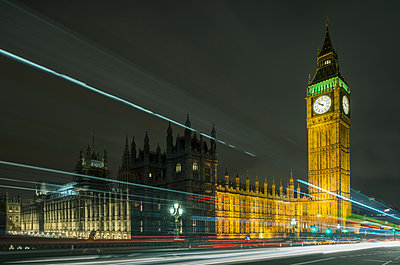Traffic light trails passing Westminster Palace and Big Ben at night, London, UK - p429m1135380f by Mischa Keijser