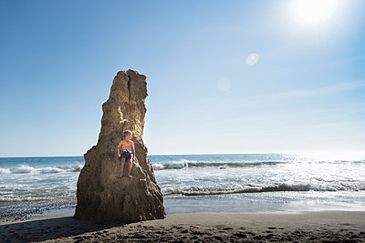 Boy on rock, El Matador Beach, Malibu, USA - p924m1557692 by JLPH