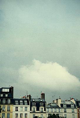 Paris apartment buildings under white cloud - p1072m829301 by Neville Mountford-Hoare
