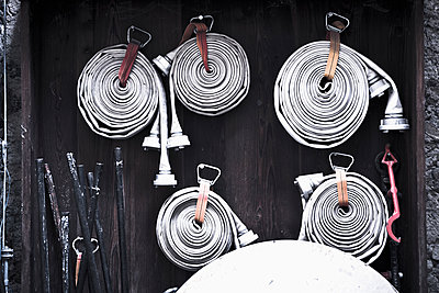 Old fire hoses - p1149m1572915 by Yvonne Röder