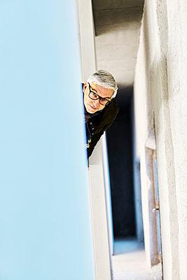 Man in stairwell - p1312m2054948 by Axel Killian