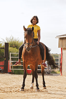Young indian girl on a horse - p1540m2109000 by Marie Tercafs