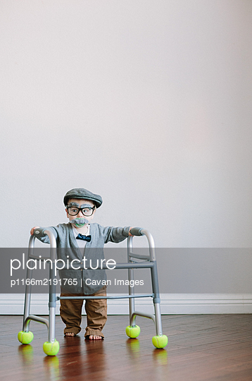 Funny Toddler Halloween Costume Old Man with Walker - p1166m2191765 by Cavan Images