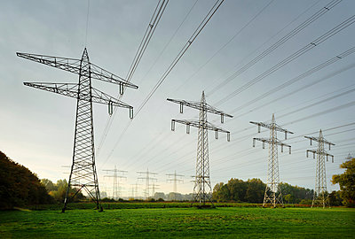 Field landscape with power lines near coal fired power station, Netherlands - p429m2058256 by Mischa Keijser