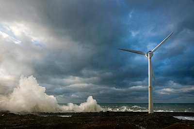Stormy sky and ocean waves splashing harbour wall and wind turbine, Boulogne-sur-Mer, Pas de Calais, France - p429m1118484f by Mischa Keijser