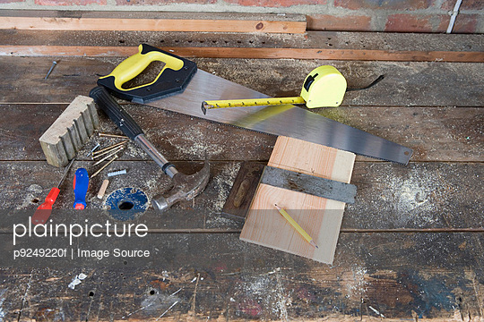 Tools on a workbench - p9249220f by Image Source