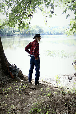 Cowboy by a River - p1019m853193 by Stephen Carroll