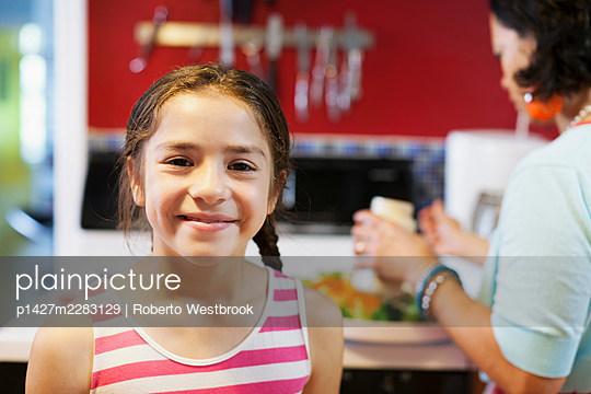 Girl looking at camera - p1427m2283129 by Roberto Westbrook