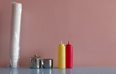 Plastic Cups on Cafe Table - p1082m894280 by Daniel Allan