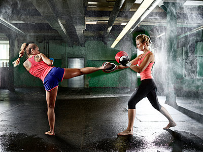 Two women having martial arts training - p300m1550240 by Christian Vorhofer
