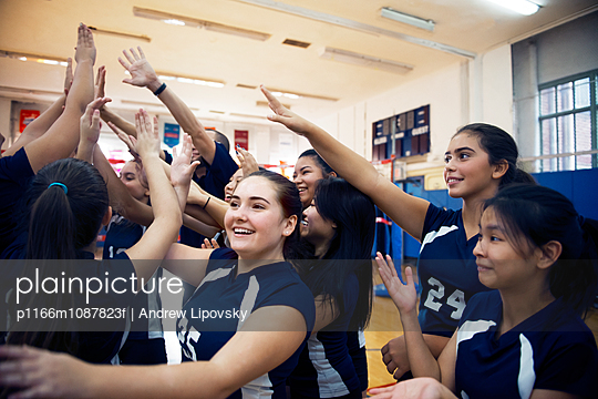 Volleyball team enjoying at court