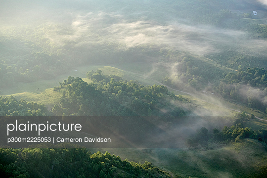 Aerial view of Appalachian forest shrouded in morning fog - p300m2225053 by Cameron Davidson