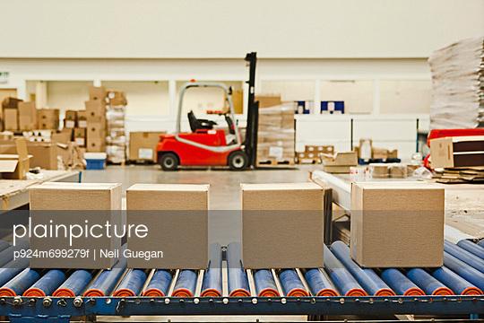 Four cardboard boxes on conveyor belt