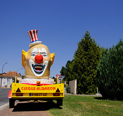 Larger clown by roadside - p1072m829447 by Neville Mountford-Hoare
