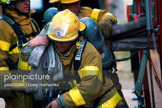 Fireman Carrying Hose
