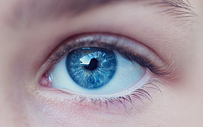 Close-up of person's blue eye - p1166m1544995 by Cavan Social