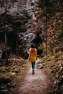 Woman is walking through the Rakov Skocjan cave system in Slovenia - p1455m2081775 by Ingmar Wein