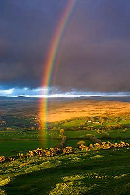 Rainbow above rolling farmland on the edges of Dartmoor National Park, Devon, England, United Kingdom, Europe - p8713080 by Adam Burton