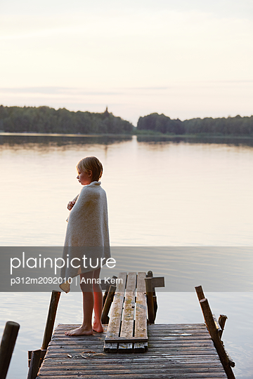 Girl standing on jetty - p312m2092010 by Anna Kern