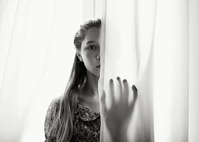 Girl with Hand on Curtain - p1503m2015902 by Deb Schwedhelm