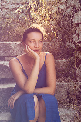 Woman in blue summer dress - p1445m2157957 by Eugenia Kyriakopoulou